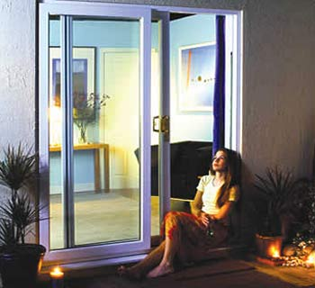 Why not make an existing window into a patio door.
